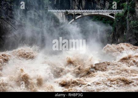 The bridge at Tiger Leaping Gorge, Yunnan Province, China - Stock Photo