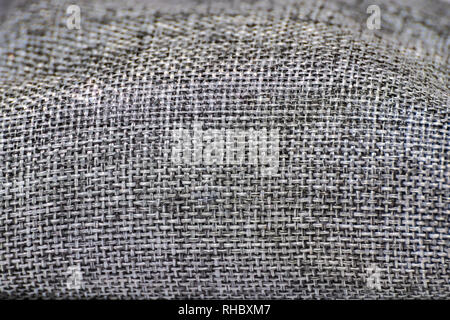 Close up on black, white, gray woven textured canvas fabric/ crocus sack - Stock Photo
