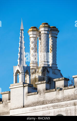 Ornate chimneys, battlementws and and roof turret on Strawberry Hill House, a Gothic Revival villa in Twickenham, London built by Horace Walpole - Stock Photo