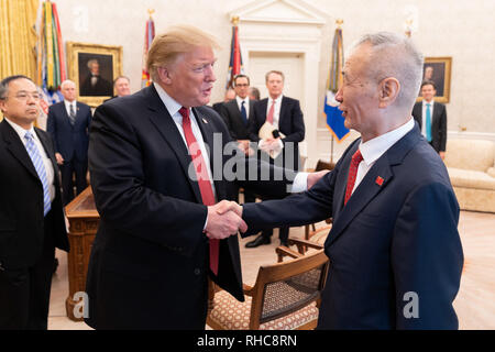 President Donald J. Trump, joined by Vice President Mike Pence, United States Trade Representative Robert Lighthizer, and other Cabinet members, welcomes Chinese Vice Premier Liu He Thursday, Jan. 31, 2019, to the Oval Office of the White House, following two days of United States–China trade talks  People:  President Donald Trump - Stock Photo