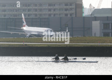 London, UK. 2nd Feb, 2019. Rowers on Royal  Docks opposite  as London City airport reopens after heavy snowfall and continuing low temperatures  forced planes to be grounded and flight cancellations Credit: amer ghazzal/Alamy Live News - Stock Photo