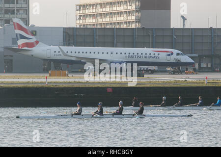 London, UK. 2nd Feb, 2019. Rowers on Royal  Docks opposite the airport runway as London City airport reopens after heavy snowfall and continuing low temperatures  forced planes to be grounded and flight cancellations Credit: amer ghazzal/Alamy Live News - Stock Photo