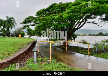 The flooded pedestrian and bicycle path on the Ross river near Bowen road, Townsville, Queensland, Australia. 2nd Feb, 2019. Flooding continued to worsen as the deluge continued and more water was released from the buldging Ross River dam to prevent the failure of the dam wall. Credit: P&F Photography/Alamy Live News - Stock Photo