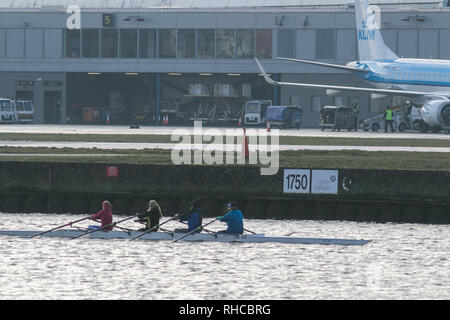 London, UK. 2nd Feb, 2019. Rowers on Royal  Docks opposite the as London City airport reopens after heavy snowfall and continuing low temperatures  forced planes to be grounded and flight cancellations Credit: amer ghazzal/Alamy Live News - Stock Photo