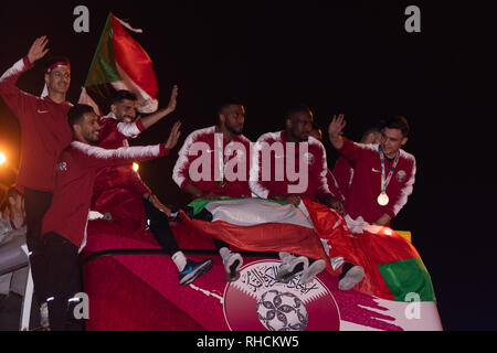 Doha, Qatar. 2nd Feb 2019. Qatar is celebrating its national football team's upset victory at the Asian Cup with a royal welcome and a street parade by jubilant fans in the capital, Doha.  Qatar on Friday defeated four-time winners Japan in the final of the 2019 AFC Asian Cup football tournament held at Abu Dhabi's Zayed Sports City Stadium in the United Arab Emirates (UAE). Credit: Ionel Sorin Furcoi/Alamy Live News - Stock Photo