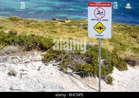Sign indicating swimming in rottnest island waters is forbidden because of the high risk to encounter native sharks. Western Australian dangers, scary - Stock Photo
