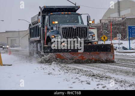 Tech. Sgt. Jason Nelson of the 171st Air Refueling Wing, Civil Engineer Squadron plows the snow to clear the roads during this mornings snowfall near Pittsburgh, Feb. 1, 2019. Nelson spent most of his morning making sure all commercial vehicles had clear, safe roads to travel on. (U.S. Air National Guard photo by Staff Sgt. Bryan Hoover) - Stock Photo