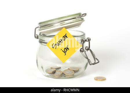 Swear jar. Glass food jar isolated on white background filled with coins and sticky note on outside - Stock Photo