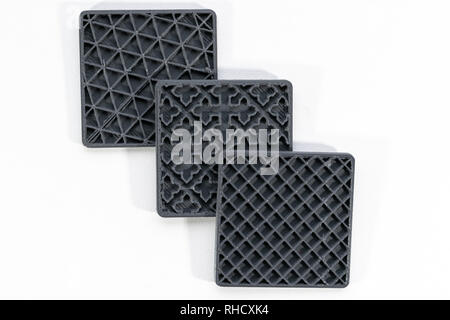 Different types of infill on 3d printed objects, white background - Stock Photo