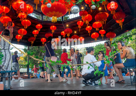 Children dancing in a silent disco while their parents watch in the Fringe World Festival Russell Square bandstand Northbridge Perth WA Australia. - Stock Photo