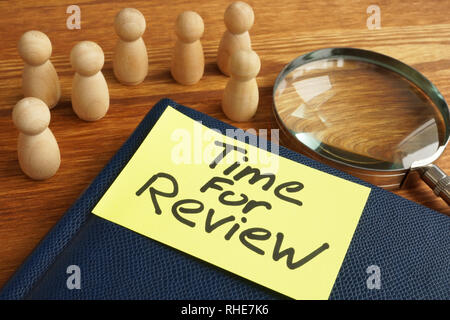 Time for review. Magnifying glass and notepad. - Stock Photo