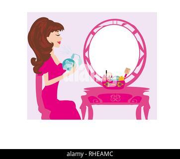 Young woman spraying perfume on herself - Stock Photo