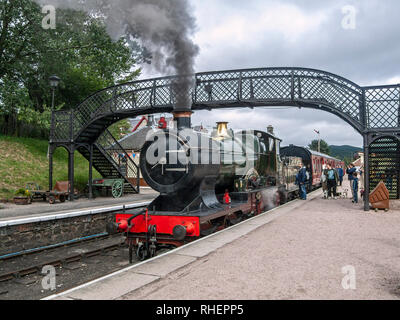 Great Western steam engine 3440 City of Truro pulling a train arriving at Boat of Garten railway station in Highland Scotland uk - Stock Photo