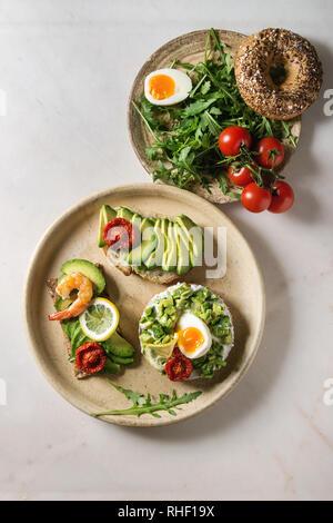 Variety of avocado sandwiches - Stock Photo