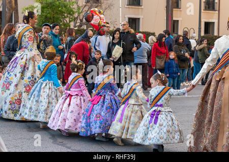 Valencia, Spain, March 16, 2018. Valencian Festival of Fallas. Festive procession in the center of the city. Teen Falleras  of Valencia. - Stock Photo