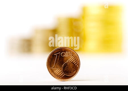 Close up of One cent Euro coin with blurred money on the white background - Stock Photo