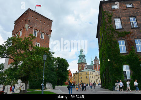 Krakow, Poland - July 13th 2018. Tourists walk around the ground of the historic Wawel Castle and Wawel Cathedral in Krakow, Poland - Stock Photo