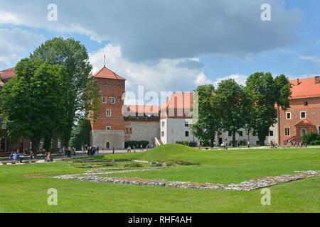 Krakow, Poland - July 13th 2018. Tourists walk around the ground of the historic Wawel Castle in Krakow, Poland - Stock Photo