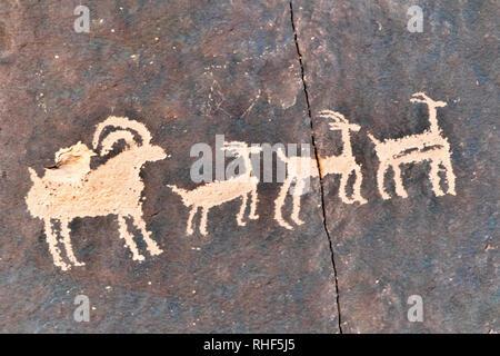 Petroglyphs at Newspaper Rock at UT 211 near Monticello, Utah, USA - Stock Photo