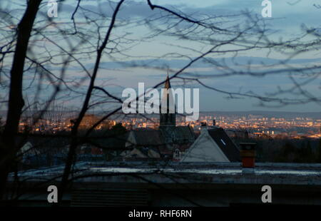 AJAXNETPHOTO. 2006. LOUVECIENNES,FRANCE. - VILLAGE CENTRE - LOOKING NORTH BY NORTH WEST TOWARD THE VILLAGE CHURCH -  EGLISE SAINT-MARTIN - AND BEYOND TO CROISSY SUR SEINE AND LE VESINET LIT BY THE SETTING SUN, FROM NEAR THE TOP OF RUE DU MARECHAL JOFFRE. A SCENE VIEWED BY 19TH CENTURY IMPRESSIONIST ARTISTS WHO LIVED IN AND VISITED THE AREA. PHOTO:JONATHAN EASTLAND/AJAX REF:D62903_776 - Stock Photo