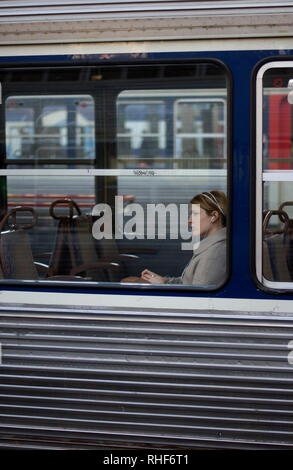 AJAXNETPHOTO. PARIS FRANCE. - THE TRAIN WAITING - PASSENGER WITH HEADPHONES IN A TRAIN WAITING TO DEPART FROM GARE ST.LAZARE. PHOTO;JONATHAN EASTLAND/AJAX REF:D82712_1833 - Stock Photo