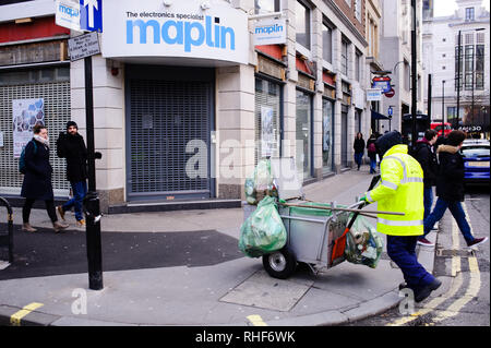 A branch of closed-down electronics retailer Maplin stands on Great Portland Street in central London. Real estate consultancy the Altus Group warned last month that it expected more than 23,000 shops to close in the UK in 2019, suggesting an even worse year for Britain's struggling high streets than 2018. Last year was one of crisis for British retailers, hit by low consumer confidence, rising rates and the challenge of online giants such as Amazon offering lower prices and reducing footfall. - Stock Photo