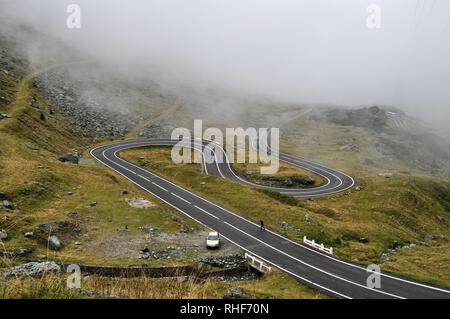 Winding mountain road Transfagarasan and fog in the Romanian Carpathians. - Stock Photo