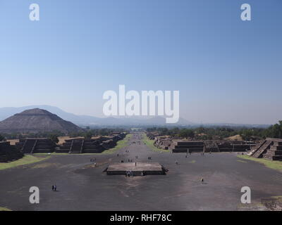 Beautiful Avenue of the Dead and pyramid of the Sun on left at Teotihuacan ruins near Mexico city landscape - Stock Photo