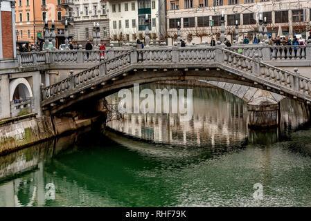 The triple bridge on the river Ljubljanica in Ljubljana, Slovenia - Stock Photo