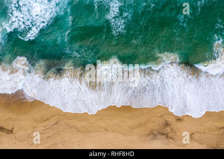 Top down view of the waves crashing onto the sand at Dudley Beach - Newcastle Australia - Stock Photo