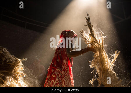 DHAKA, BANGLADESH - JANUARY 24 : Women working in dust environmentinside at jute processing mill near Dhaka, Bangladesh on January 24, 2019. - Stock Photo