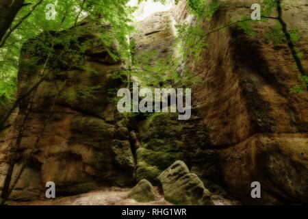 Huge Monument Of Sandstone Surrounded by Trees In Saxony Switzerland. - Stock Photo