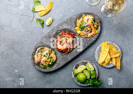 CEVICHE. Three colorful shrimps ceviche with mango, avocado and tomatoes. Latin American Mexican Peruvian Ecuadorian food. Served with white wine and - Stock Photo