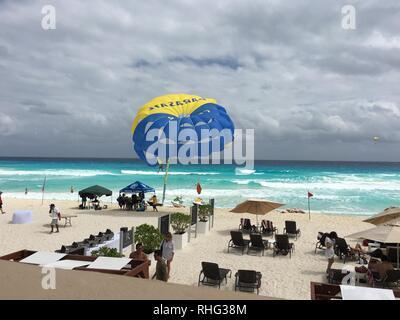 Fun on the beach in Cancun, Mexico - Stock Photo