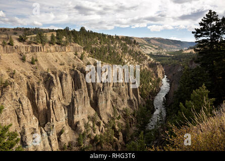 Basaltic columns and spires form the walls of the Canyon of the Yellowstone River viewed from the Calcite Springs Overlook in Yellowstone Natl. Park. - Stock Photo