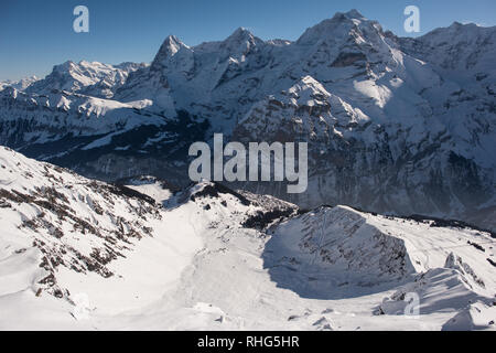 the famous mountains in switzerland eiger monk and jungfrau, below in the picture the mountain village mürren which can be reached only with the aeria - Stock Photo