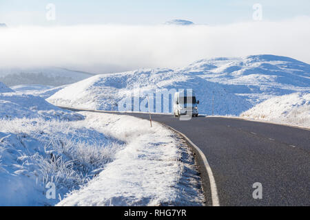 Bitterly cold morning with freezing fog and hoar frost turning the scene into a winter wonderland on A82 at Rannoch Moor, Highlands Scotland in Winter - Stock Photo