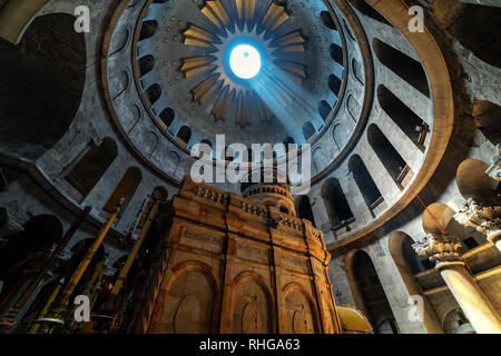 Ray of sunlight breaks through the ceiling over the tomb of Jesus in the Church of the Holy Sepulchre in Jerusalem, Israel. - Stock Photo