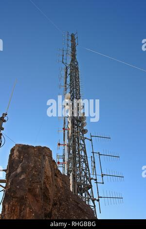 rocky mountain of the Apuan Alps in Tuscany on which they have installed high telecommunications antennas - Stock Photo