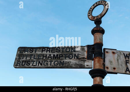 Worn out directional street sign from East Preston, West Sussex, UK - Stock Photo