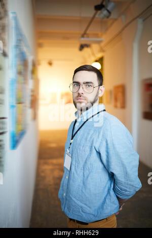 Pensive Man in Art Gallery - Stock Photo