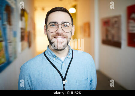Smiling Bearded Man in Art Gallery - Stock Photo
