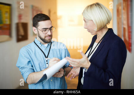 Two Workers in Art Gallery - Stock Photo