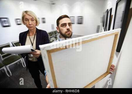 Setting Up Exhibition in Gallery - Stock Photo