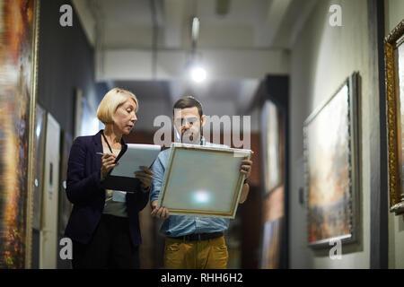 Art Curators in Museum - Stock Photo