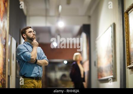 Man in Art Gallery - Stock Photo