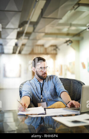 Businessman Working in Art Space - Stock Photo