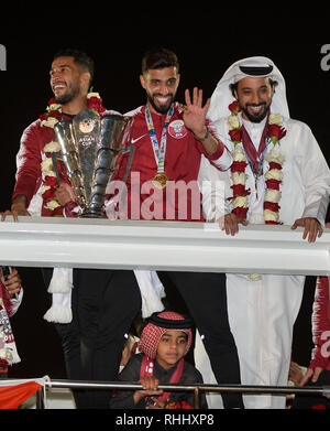 Doha, Qatar. . 2nd Feb, 2019. Qatar national soccer team captain and forward Hasan Al Haydos (C) waves to fans upon arrival at Doha International Airport in Doha, Qatar on Feb. 2, 2019. Qatar won 3-1 over Japan to claim the title of the AFC Asian Cup for the first time. Credit: Nikku/Xinhua/Alamy Live News - Stock Photo