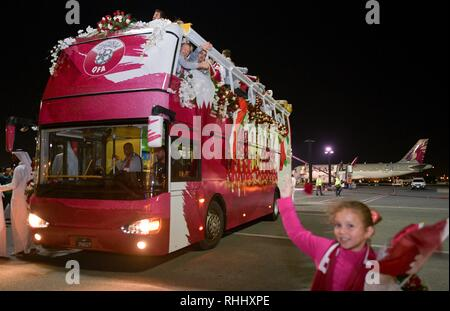 Doha, Qatar. . 2nd Feb, 2019. Qatari national soccer team players wave to fans on a bus upon arrival at Doha International Airport in Doha, Qatar on Feb. 2, 2019. Qatar won 3-1 over Japan to claim the title of the AFC Asian Cup for the first time. Credit: Nikku/Xinhua/Alamy Live News - Stock Photo