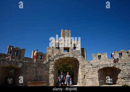 Rhodes Town resembles a medieval time capsule behind a ring of high walls .It has many layers of architectural history in a maze of narrow streets. - Stock Photo